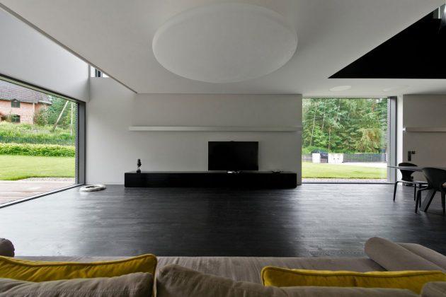В интерьере дома в стиле минимализм присутствует минимум мебели